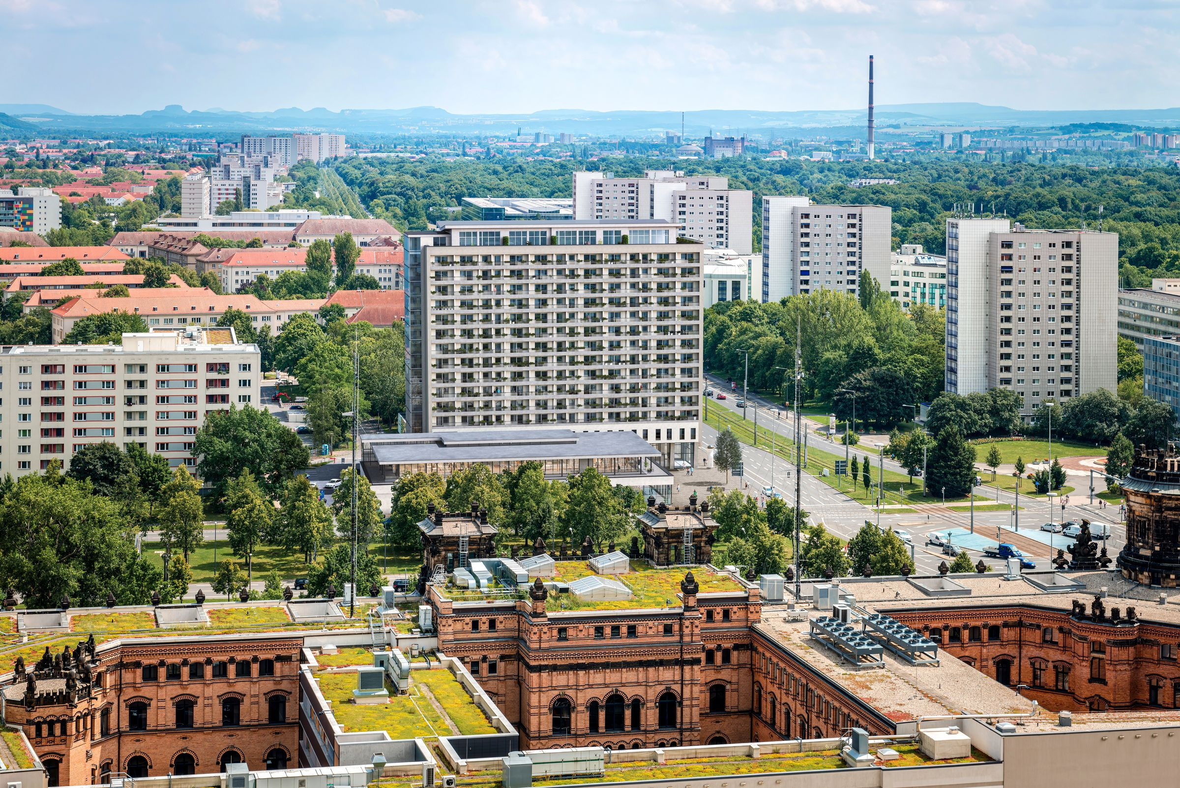 Aerial view of Dresden, looking East, with the rooftops of the building of the Police Department in the foreground and typical soviet apartment blocks in the background.